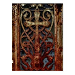 Rusted gothic crypt door postcard