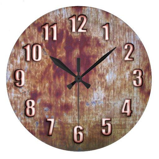 Rusted metal with sleek bronze numbers round wallclock