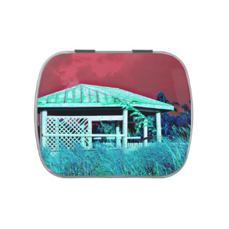 rusted roof beach dune building green red candy tins