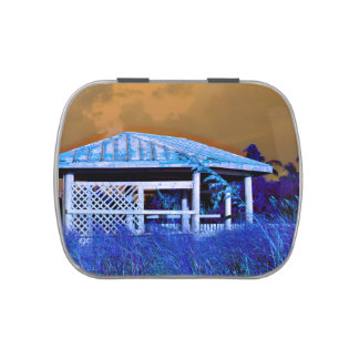 rusted roof beach dune building orange blue jelly belly candy tins