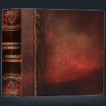 """Rustic Antique Ancient Tome Faux Red Leather Binder<br><div class=""""desc"""">Ornate scrollwork,  weathered grunge detail,  and faux leather enriched with a beautiful aged texture create a truly authentic looking &#39;ancient tome&#39; disguise for this trendy three-ring binder.</div>"""
