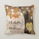 """Rustic Autumn Tree Monogram Newlywed Couple Throw Pillow<br><div class=""""desc"""">Autumn woodland newlywed pillow featuring a rustic fall tree covered in red, orange and yellow leaves, a carved heart with their initials, string twinkle lights and a modern text template. For further customization, please click the """"Personalize it"""" button to modify this template. All text style, colors, and sizes can be...</div>"""