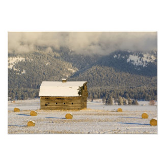 Rustic barn and hay bales after a fresh snow 2 photographic print