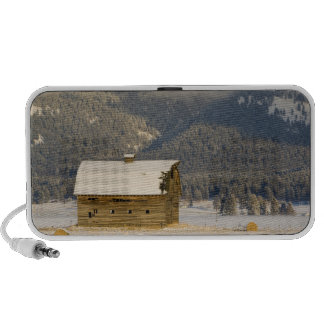 Rustic barn and hay bales after a fresh snow 2 laptop speaker