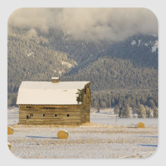 Rustic barn and hay bales after a fresh snow 2 square sticker
