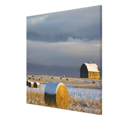 Rustic barn and hay bales after a fresh snow 3 stretched canvas prints