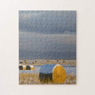 Rustic barn and hay bales after a fresh snow 3 jigsaw puzzle
