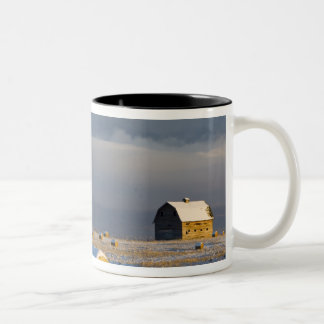 Rustic barn and hay bales after a fresh snow 3 Two-Tone coffee mug