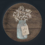 "Rustic Barn Wedding Wood Mason Jar Babys Breath Paper Plate<br><div class=""desc"">This is a beautiful country rustic wedding design featuring white baby&#39;s breath florals inside a mason jar. You can customize this design further by clicking on the CUSTOMIZE IT button. I am able to design any matching item so be sure to contact me if you need something else made just...</div>"