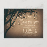 "rustic country lights mason jars save the date announcement postcard<br><div class=""desc"">Romantic vintage save the date with rustic old tree branches,  glowing string lights and and mason jars full of fireflies.</div>"