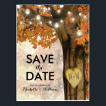 "Rustic Fall Autumn Tree Lights Save the Date Postcard<br><div class=""desc"">Autumn woodland save the date postcards featuring a rustic fall tree covered in red, orange and yellow leaves, a carved heart with your initials, string twinkle lights and a modern wedding text template. For further personalization, please click the &quot;Customize it&quot; button to modify this template. All text style, colors, and...</div>"