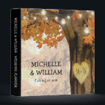 """Rustic Fall Autumn Tree Twinkle Lights Wedding 3 Ring Binder<br><div class=""""desc"""">Autumn woodland wedding planner album featuring a rustic fall tree covered in red, orange and yellow leaves, a carved heart with your initials, string twinkle lights and a modern text template. For further customization, please click the &quot;Personalize it&quot; button to modify this template. All text style, colors, and sizes can...</div>"""