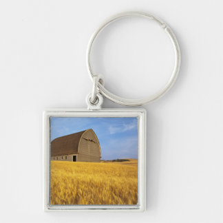 Rustic old barn in mature wheat field in the 2 keychains
