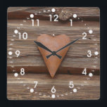 """Rustic Old Heart on Log Cabin Wood Square Wall Clock<br><div class=""""desc"""">Rustic and Rusty Old Heart Home Decor Piece hanging on the side of a Log Cabin Wood Wall.  These make great gifts for country stores and anyone who loves rustic primitive design items.</div>"""