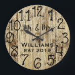 "Rustic Personalized Brown Wood Custom Large Clock<br><div class=""desc"">Beautiful, unique, one-of-a-kind personalized design features a faux-rustic brown wood with black personalization his and her names in a script font overlay design and the last name and year established in a bold script with a printed wood effect background. Personalize this clock by adding your personal information. Makes a great...</div>"
