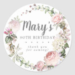 "Rustic Pink Floral 90th Birthday Thank You Classic Round Sticker<br><div class=""desc"">Soft blush pink roses and bright pink buds create a beautifully rustic floral wreath. White hydrangeas at to the floral bloom. The birthday woman's name is written in a large script font. 90th Birthday and the thank you sentiment follow. This birthday sticker is part of the 90th Birthday Pink Rose...</div>"