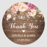 """Rustic Pink Floral String Lights Wedding Thank You Classic Round Sticker<br><div class=""""desc"""">Customize this """"Rustic Pink Floral String Lights Wedding Favor Thank You Sticker"""" to add a special touch. It's perfect for all occasions. (1) For further customization, please click the """"customize further"""" link and use our design tool to modify this template. (2) If you need help or matching items, please contact...</div>"""