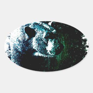 Rustic polar bear on black background oval sticker