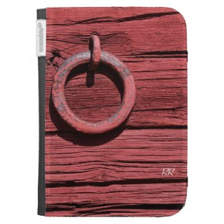 A Rustic Red Barn Wood with Metal Ring effect on an Amazon Kindle Sleeve