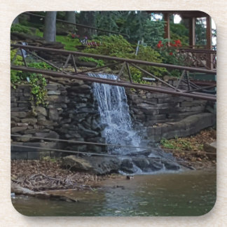 Rustic Rocky Waterfall On the Shoreline of Lake Coaster