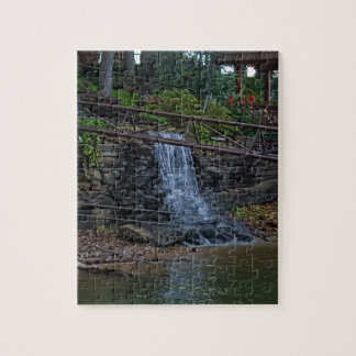 Rustic Rocky Waterfall On the Shoreline of Lake Jigsaw Puzzle
