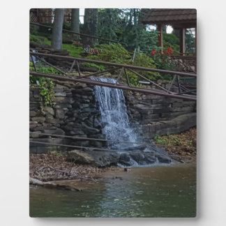 Rustic Rocky Waterfall On the Shoreline of Lake Plaque