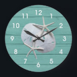 """Rustic Sand Dollar Starfish Wall Clock<br><div class=""""desc"""">This design features a couple white sand dollars and starfish. The background is a seafoam green wood grain background.</div>"""