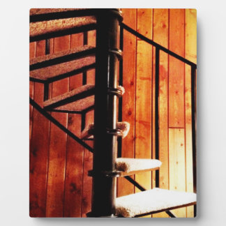 Rustic spiral staircase at cabin display plaques