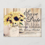 """Rustic Sunflower Mason Jar Save the Date Postcards<br><div class=""""desc"""">Rustic Country Sunflower Mason Jar Save the Date Postcards with a barn wood background. These are great for country weddings. The mason jar are painted and have a twine bow around them and a bouquet of sunflowers inside sitting on a lace doily. The back of the postcard has a return...</div>"""