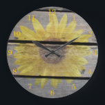 """Rustic Sunflower On Wood Large Clock<br><div class=""""desc"""">A faded sunflower on faded wood. This would look nice as part of a country kitchen decorating scheme.</div>"""