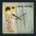 """Rustic Sunflowers &amp; Mason Jar Kitchen Clock<br><div class=""""desc"""">A jar full of sunflowers with a rustic effect. The text can be changed to your name.</div>"""