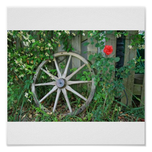 Rustic Wagon Wheel Against Fence with Red Rose Poster