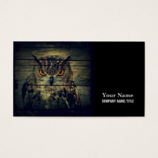Rustic wild owl on barnboard background business card