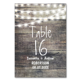 Rustic wood and string lights table number card