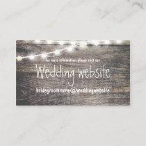Rustic wood and string lights wedding website enclosure card