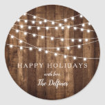 "Rustic Wood Fairy Lights Customized Holiday Classic Round Sticker<br><div class=""desc"">Rustic Wood Fairy Lights Customized Holiday Classic Round Stickers make the perfect envelope seals for your holiday cards. Personalized with your family's name in a pretty script font, the barn wood and fairy light accents bring a rustic touch to your envelopes. Personalize with name and details by clicking ""Customize It""!...</div>"