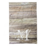 Rustic Wood Monogrammed Kitchen Towel<br><div class='desc'>Detailed photograph of weathered old boards on a dock. Shows wood grain, knots, and aging in these beautiful boards that have been exposed to sun, moisture and salt for many years. Add a custom monogram in a Lacy weathered look and you&#39;ve got rustic elegance of shabby chic for any cowgirl...</div>