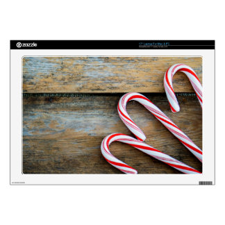 """Rustic Wood with Christmas Candy Canes 17"""" Laptop Skins"""