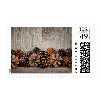 Rustic wood with pine cones postage