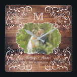 "Rustic Woodland Wedding Photo Wood Panel Monogram Square Wall Clock<br><div class=""desc"">Celebrate your wedding with this rustic, woodland-themed, monogram photo frame design. Elegant white frame with fancy corners made of leaves, flowers, hearts and curly cues on a wood panel background await your favorite wedding photograph. Replace the sample photo and text with your own for a keepsake, personalized gift. Makes a...</div>"