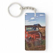 Rusting orange Dodge truck with abandoned farm Keychain