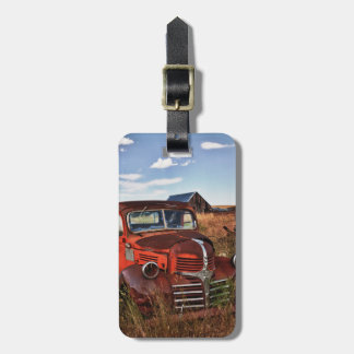 Rusting orange Dodge truck with abandoned farm Travel Bag Tags
