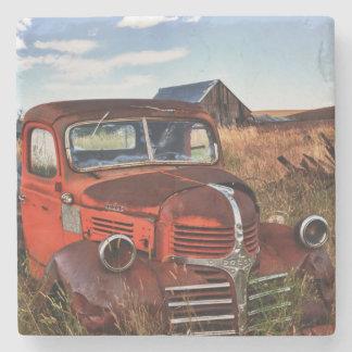 Rusting orange Dodge truck with abandoned farm Stone Coaster