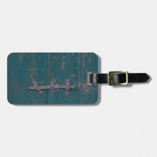 Rusty Door Latch On Green Door Luggage Tag