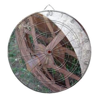 Rusty iron wheel of old cart dartboard