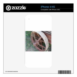 Rusty iron wheel of old cart iPhone 4 skin