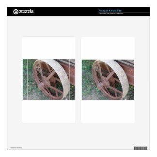Rusty iron wheel of old cart kindle fire skin