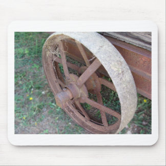 Rusty iron wheel of old cart mouse pad