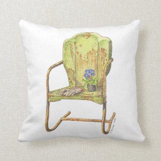 rusty vintage garden chair on pillow