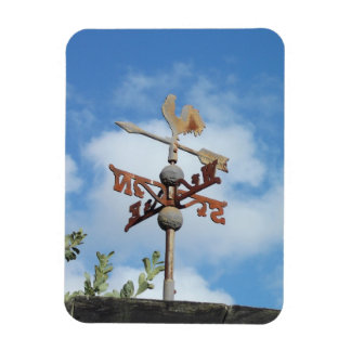 Rusty Weathervane against blue sky Magnet
